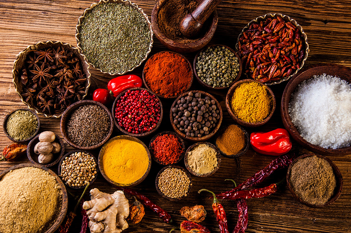 Oriental hot spices on wooden table